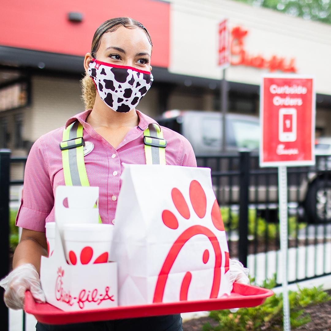 Chick-fil-A team member delivers order curbside